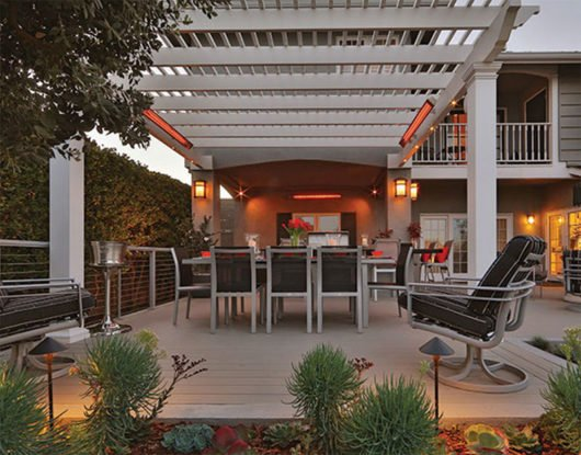 Infratech slimline patio heater heats a patio under an arbor.